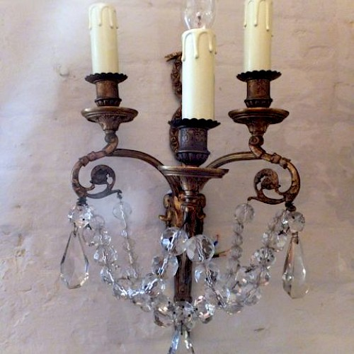 A Pair of French Crystal and Bronze Sconces